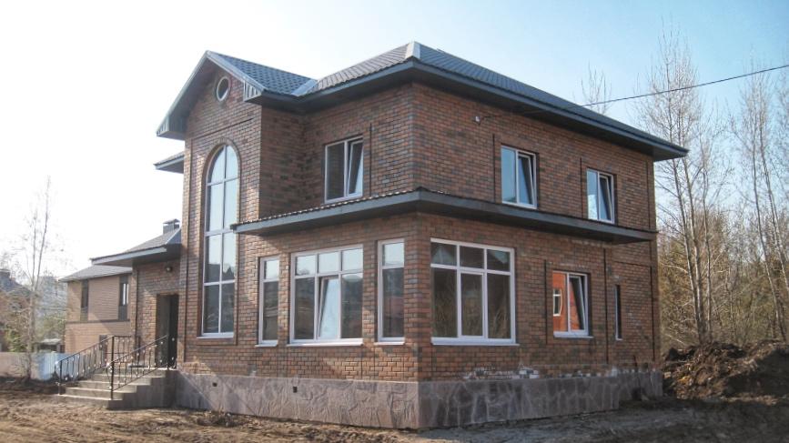 Строительство двухэтажного дома с пристроем